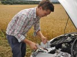 Carbecue student cooks steak and duck breast on the engine of his Ford Ka